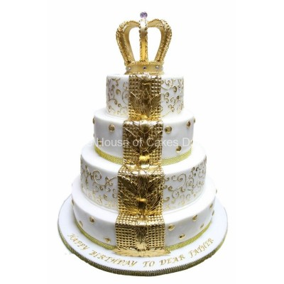 White and gold fleur de lis cake with crown