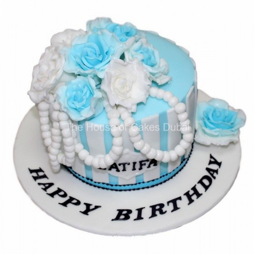 Blue and white cake with pearls