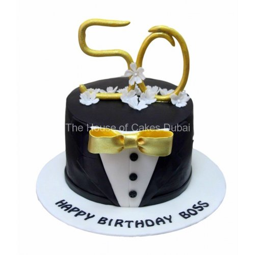 50th birthday cake with gold bow