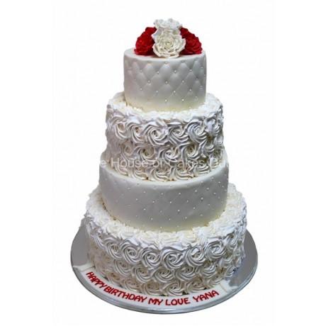 Cake with white swirl rosettes and diamond design