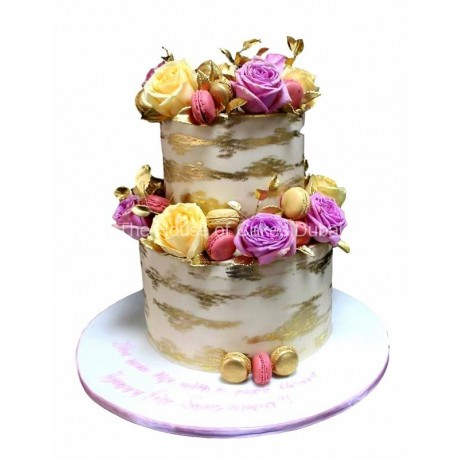 gold macarons yellow and purple roses cake 12