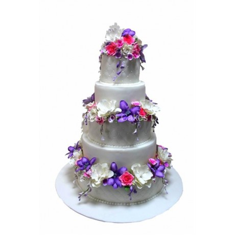 Cake with purple pink and white flowers