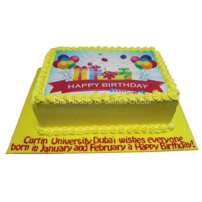 Yellow happy birthday cake