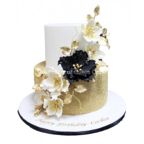 elegant gold white and black cake 7