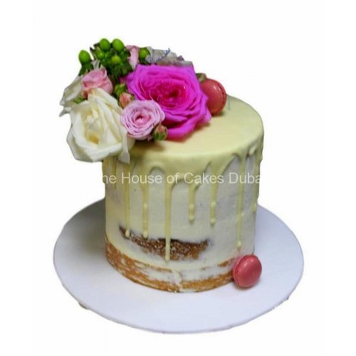 Naked dripping cake with roses
