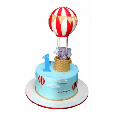 First birthday cake with elephant and balloon