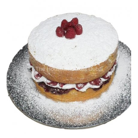 Naked cake with cream and raspberries