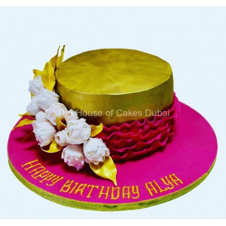 Gold and bright pink cake with flowers