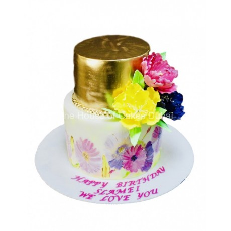 Gold and white cake with flowers 3