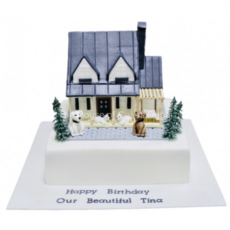Country house cake with dogs and cats