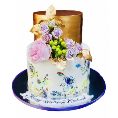 bronze and white cake with flowers 7