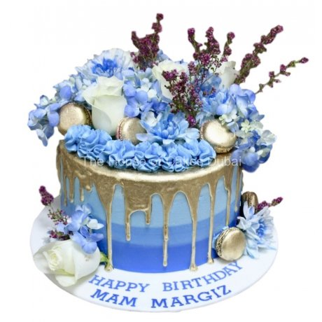 blue cake with gold dripping 6