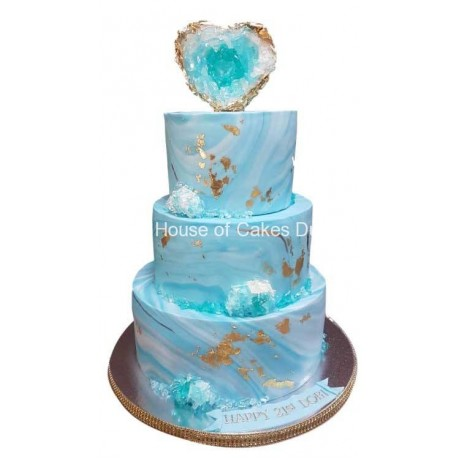 Light blue and gold cake with crystal heart