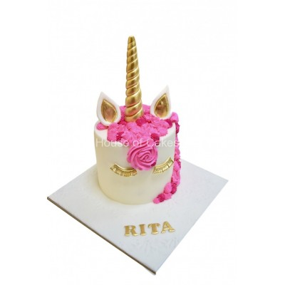 Unicorn cake with gold lashes