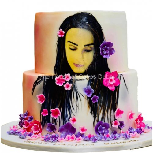 cake with face drawing and flowers 7
