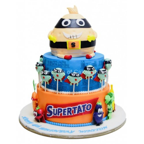 Supertato themed cake with cake pops on it