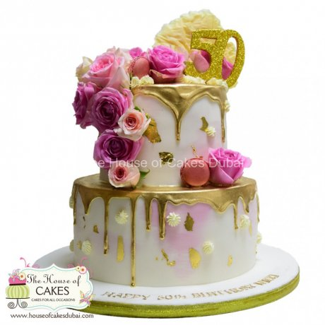 Gold dripping and pink roses cake