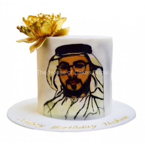 cake with face drawing and gold flower 7