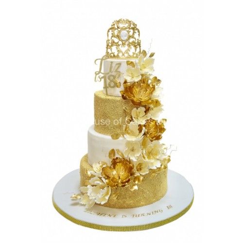 Gold and white cake with crown