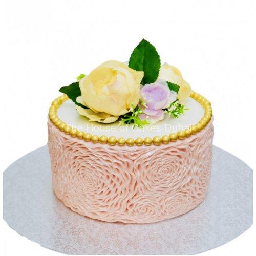 Peach ruffles cake with flower