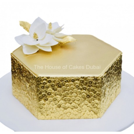 gold sequins cake with white flower 6