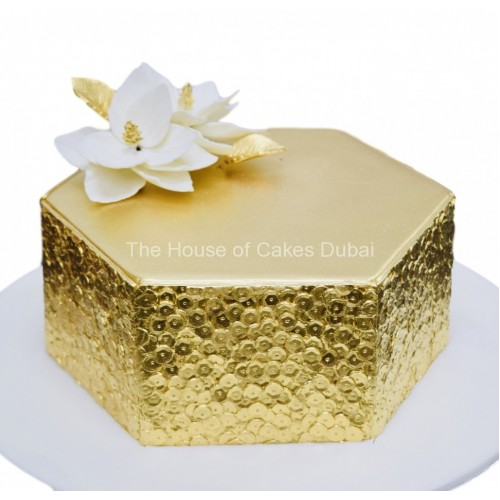 gold sequins cake with white flower 7