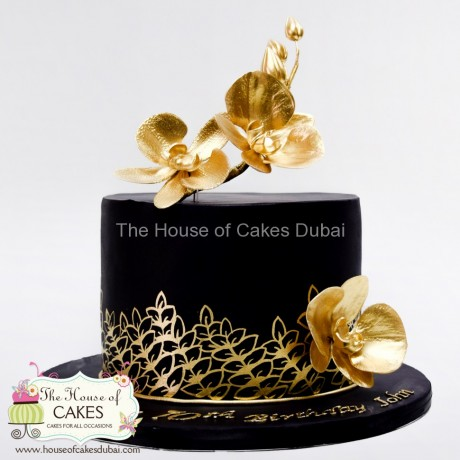 Black cake with gold flowers