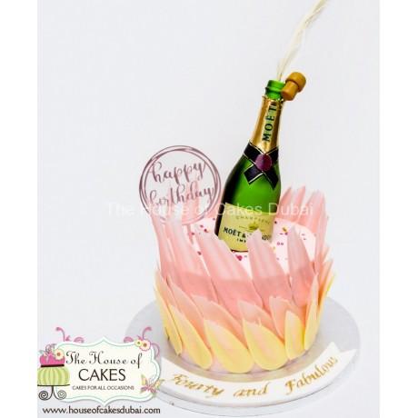 Celebration cake with Moët & Chandon Champagne bottle