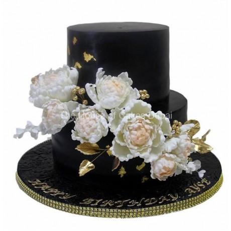 Black and white cake with sugar peonies