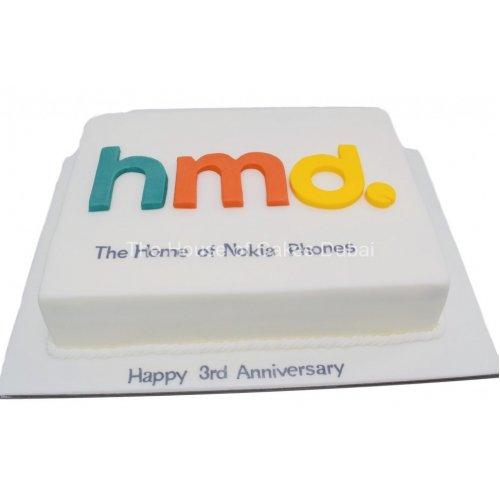 HMD Cake with company logo
