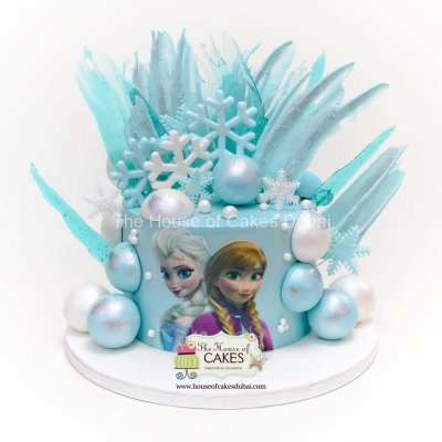 Frozen theme cake with chocolate spheres and brushstrokes