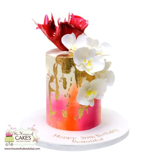 Trendy cake with orchids and pink sail