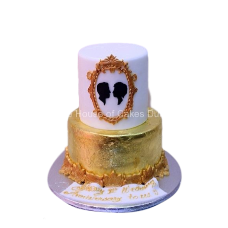 gold and white cake with couple in frame 6