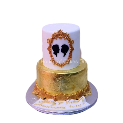 gold and white cake with couple in frame 7