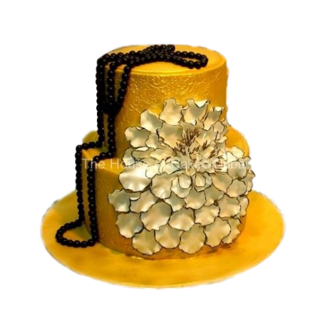 Gold cake with white flower