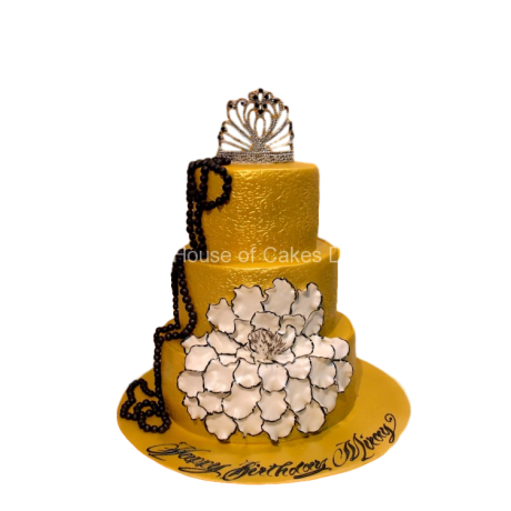 Gold cake with crown and flower